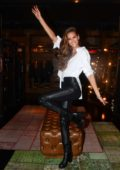 Izabel Goulart rocked black leather pants and white shirt at a designer store opening party in Sao Paulo, Brazil