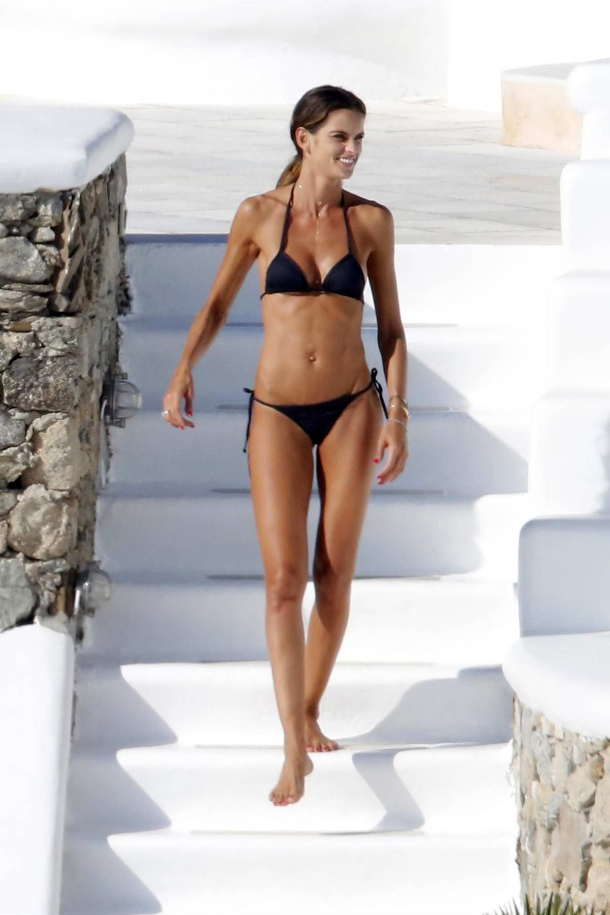 Izabel Goulart seen while relaxing by the pool in a bikini during her vacation in Mykonos, Greece