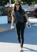 Jessica Gomes steps out in a dark grey tee and black skinny jeans as she runs errands in Beverly Hills, Los Angeles