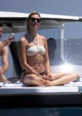 Karlie Kloss wears a black and white bikini as she enjoys a day on a yacht with boyfriend Joshua Kushner and her friends while on holiday in Capri, Italy