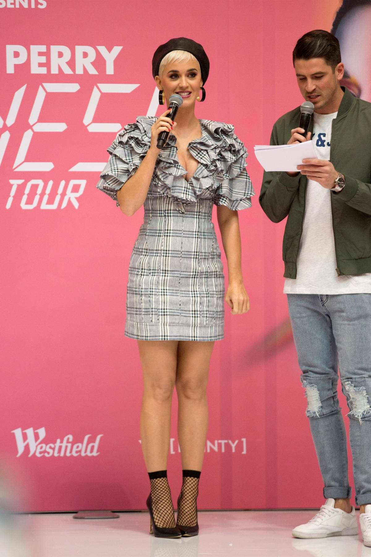 Katy Perry looks cute in a short plaid dress with a beret during a Q&A session at Myer store in Adelaide, Australia