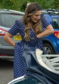 Kelly Brook wears a blue and white polka-dot dress while filming Antiques Roadshow in Battle, East Sussex, UK