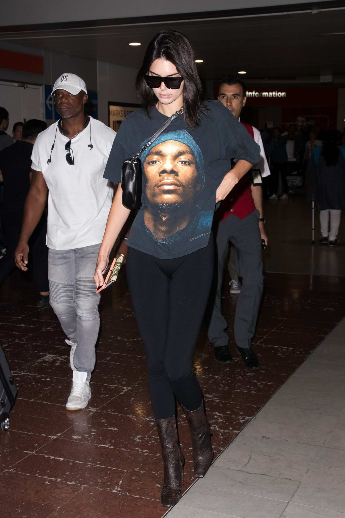 Kendall Jenner arrives at the Paris-Charles-de-Gaulle airport before heading off to her hotel in Paris, France