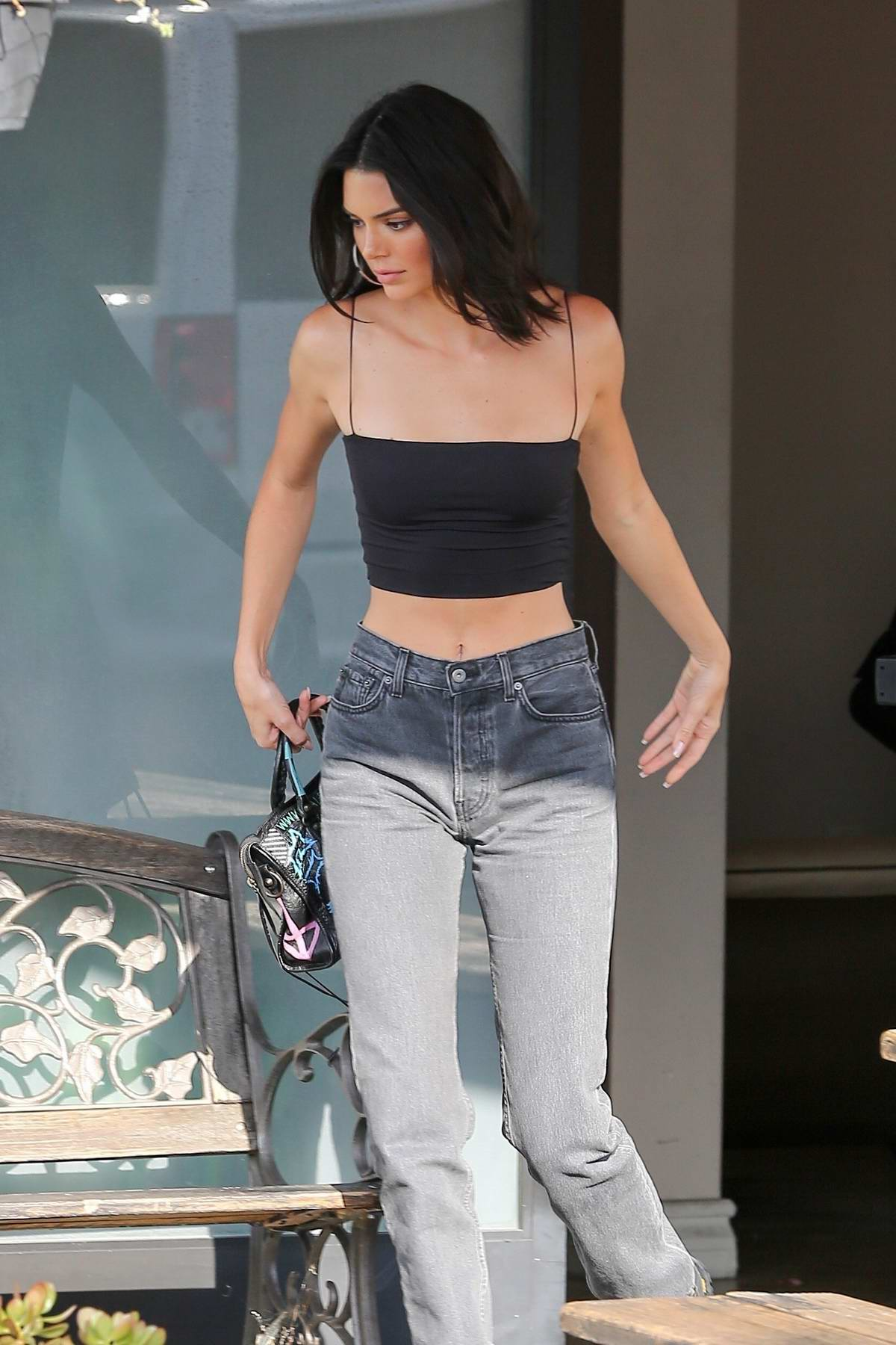 Kendall Jenner leaves the studio in a black corset top in Calabasas, California