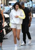 Kendall Jenner seen wearing white Adidas jacket and shorts as she leaves Alexander Wang before heading out to lunch at the L'Avenue restaurant in Paris, France