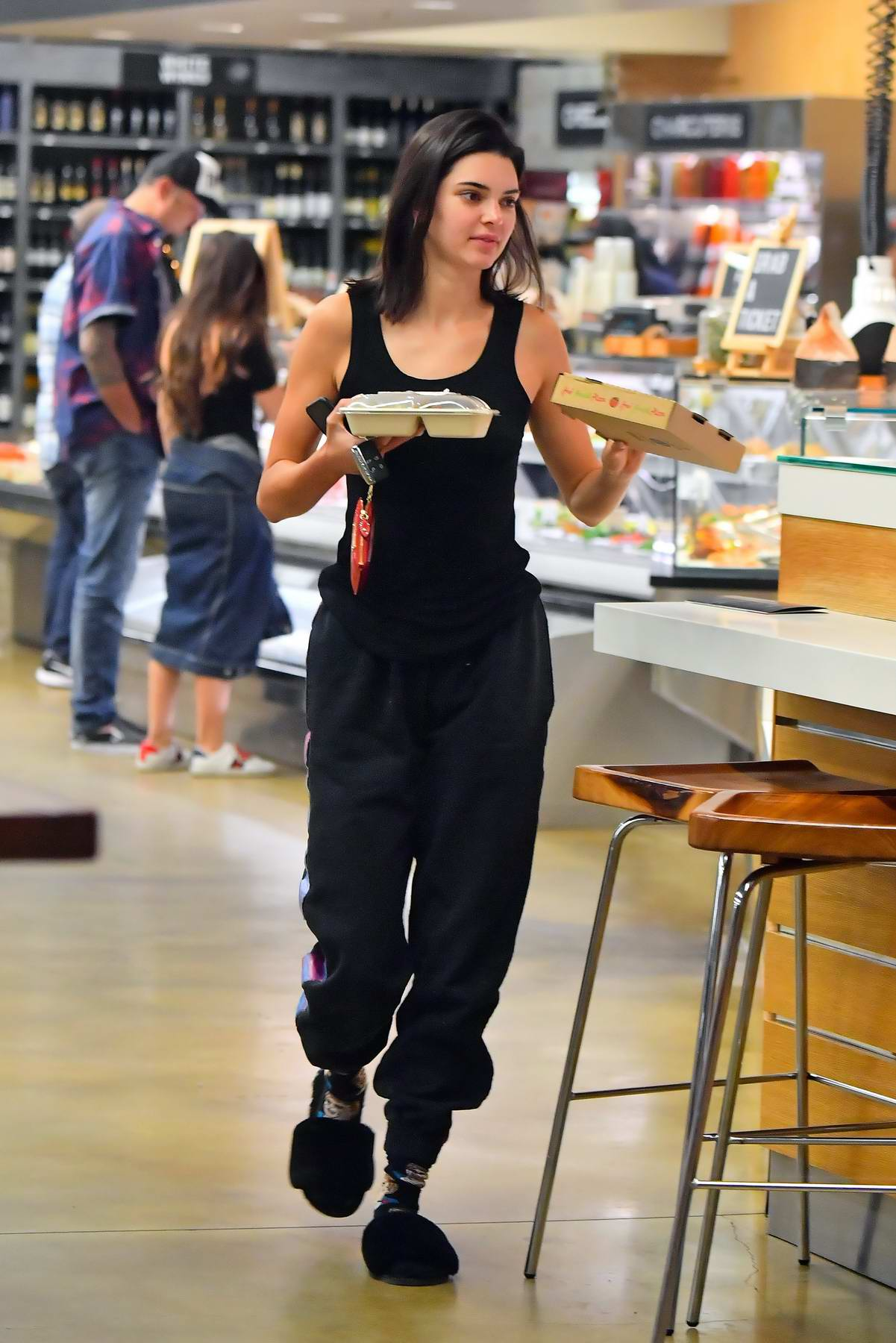 Kendall Jenner stops by a grocery store for a late night slice of pizza in Los Angeles