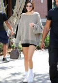 Kendall Jenner wears over-sized sweater and biker shorts as she arrives at a greek yogurt place to meet up with her family in Calabasas, California