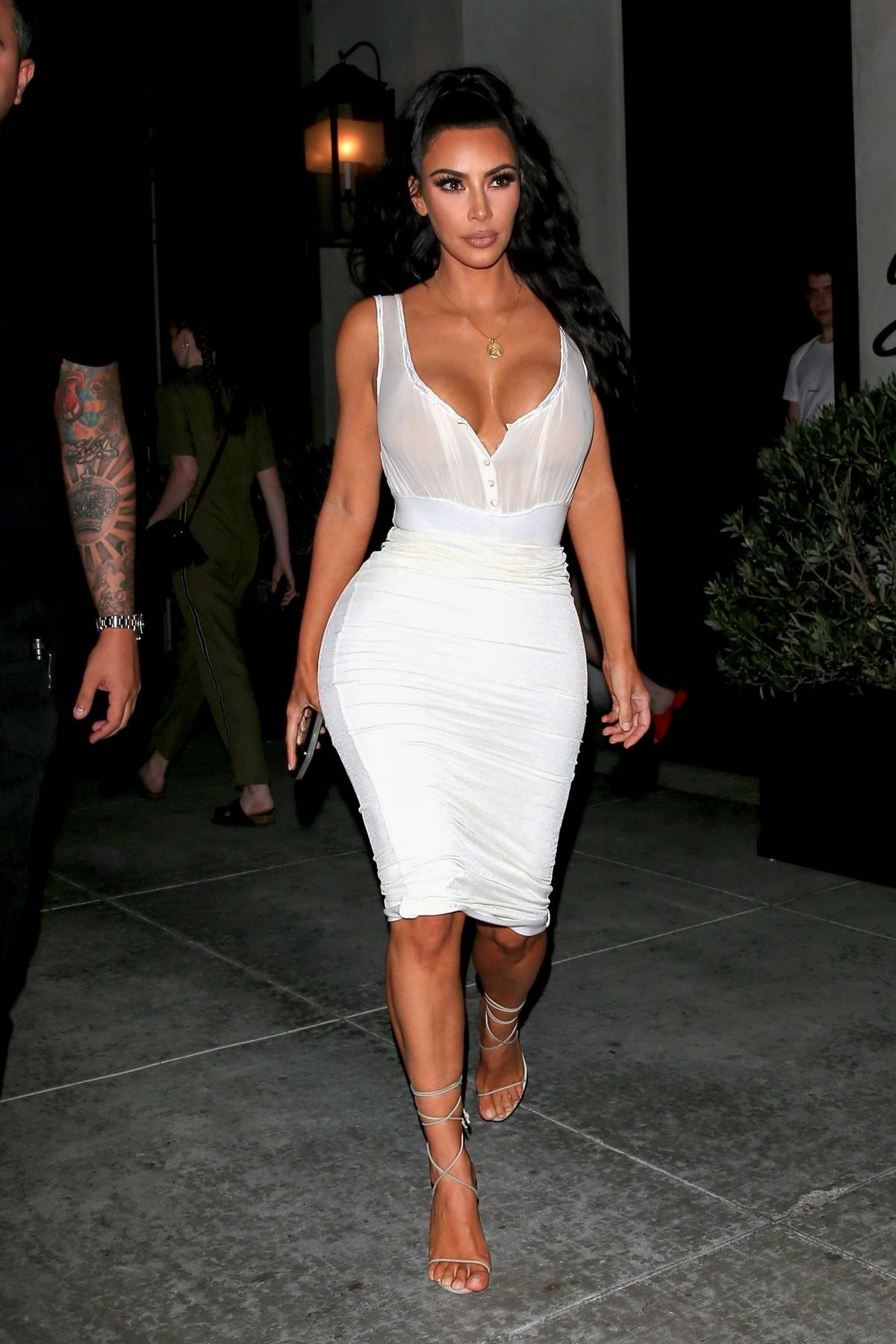 Kim Kardashian spotted in a white dress while leaving after dinner at Spago's in Los Angeles