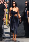 Kim Kardashian wears navy blue top with matching velvet tights as she arrives for 'Jimmy Kimmel Live' in Hollywood, Los Angeles