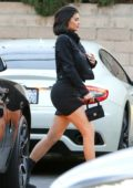 Kylie Jenner seen wearing a black short skirt with matching black jacket as she heads to dinner with friends in Beverly Hills, Los Angeles