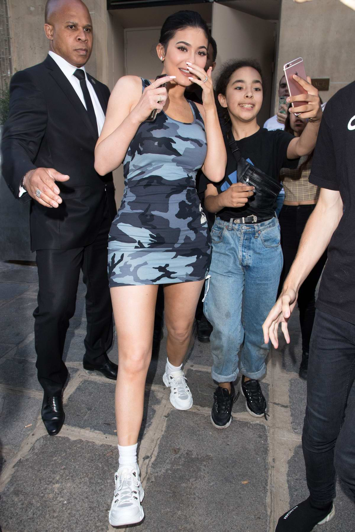 Kylie Jenner wearing a camo dress as she leaves her hotel in Paris, France