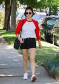 Lucy Hale wears a red and white baseball tee and denim shorts while out to lunch at Aroma Coffee and Tea in Studio City, Los Angeles