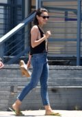 Mila Kunis wears a cropped 'Shark Man' tank top while visiting a nail salon with a friend in Los Angeles