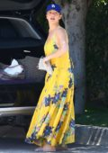 Minka Kelly steps out in a yellow summer maxi dress as she heads to a friend's house in Hollywood, Los Angeles