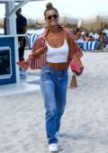 Nina Agdal looks cool in white spaghetti top and blue jeans while at the beach in Miami, Florida