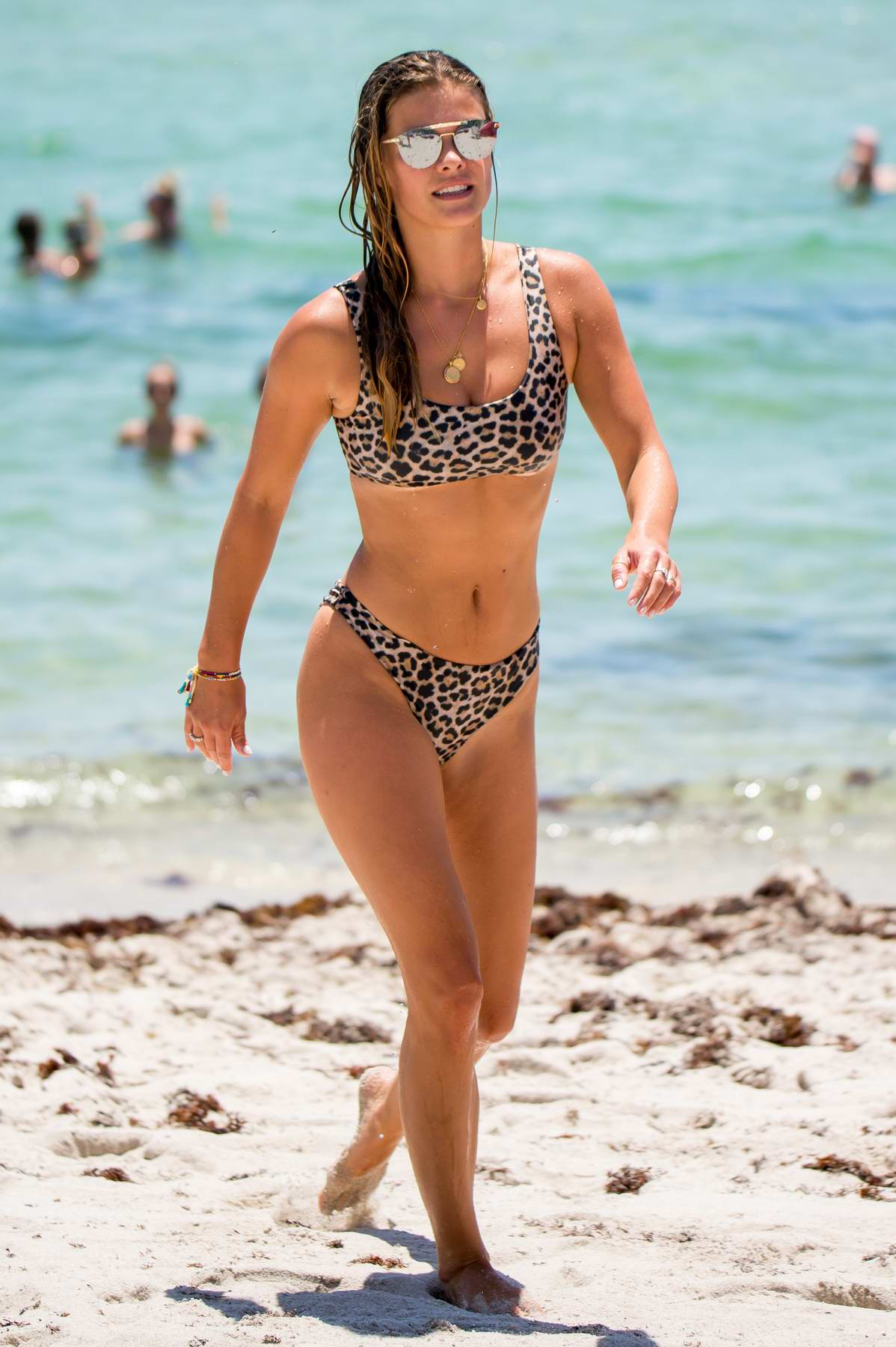 Nina Agdal shows off her beach body in a leopard print bikini while she cools down in the ocean with her friends in Miami, Florida