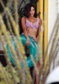 Olivia Culpo dons a striped bikini during a photoshoot in Palm Springs, California