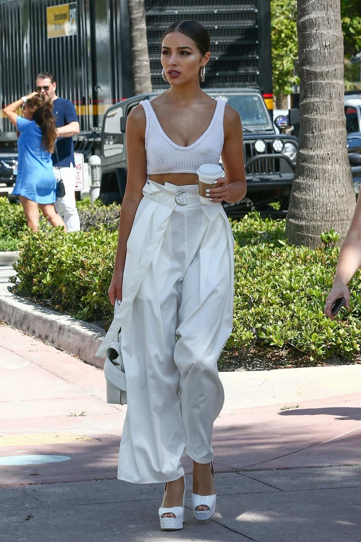 Olivia Culpo looks chic in her all white ensemble while making a coffee run in Miami, Florida