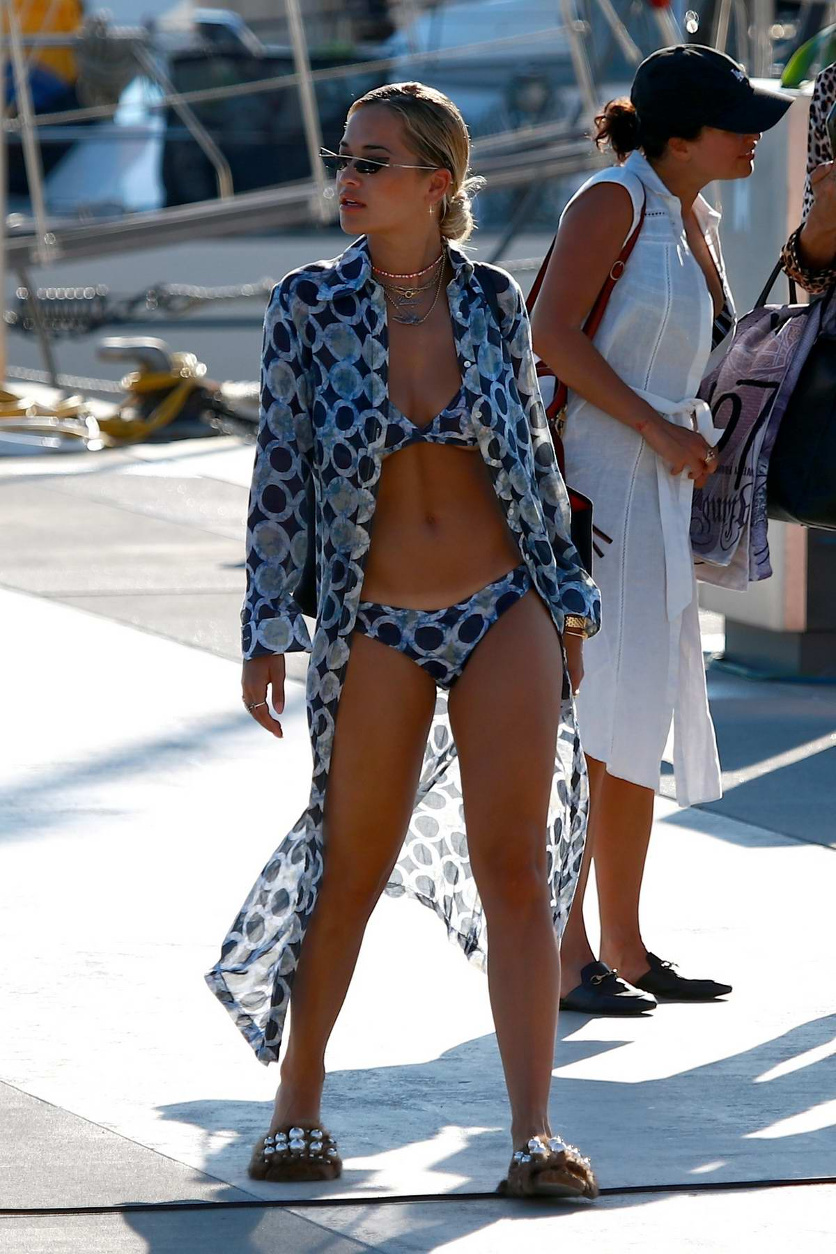Rita Ora spotted in a patterned bikini as she returns after a boat ride with her friends in Barcelona, Spain