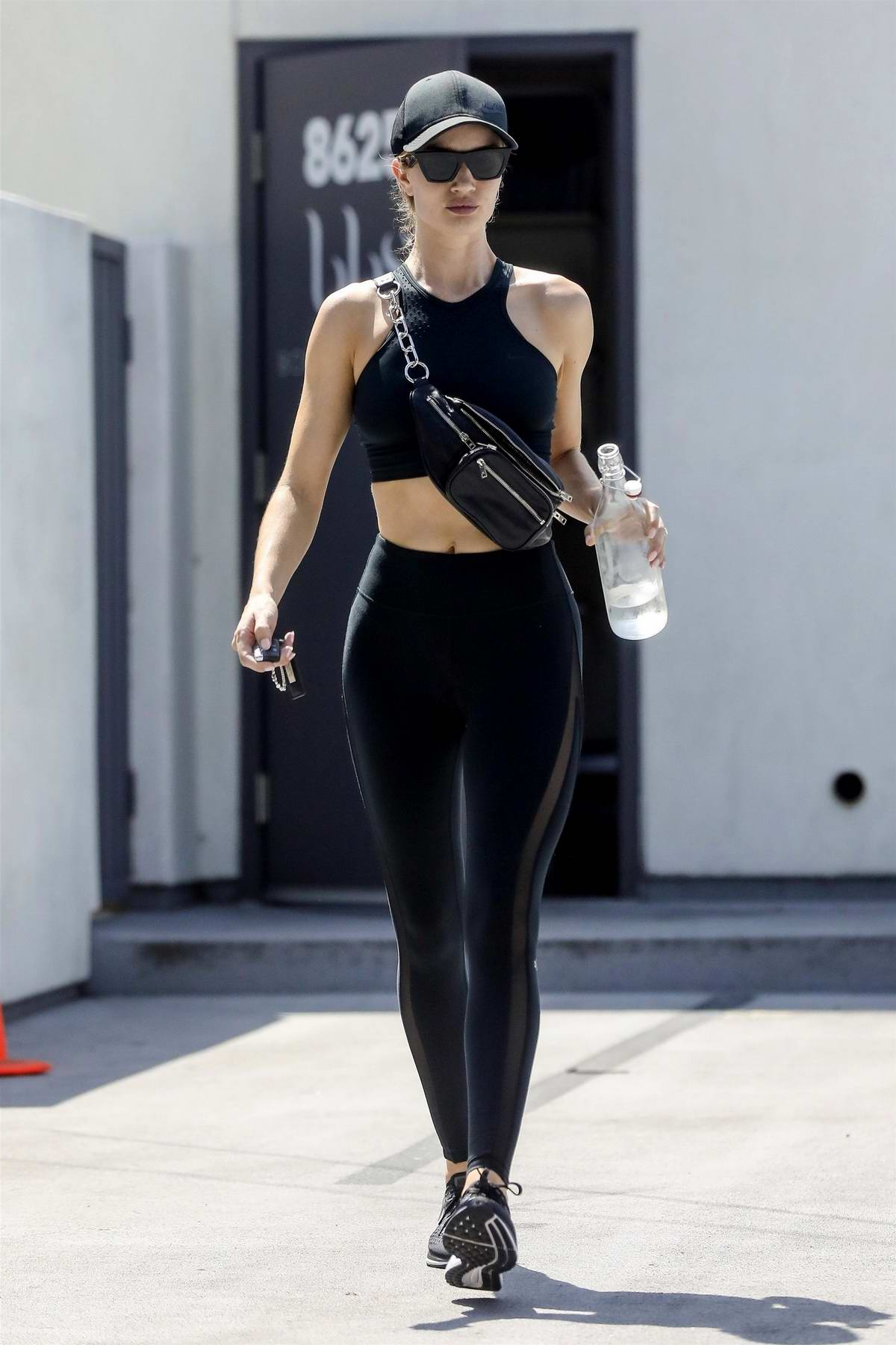Rosie Huntington-Whiteley looks radiant as she leaves Body by Simone after a workout session in Los Angeles