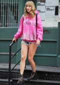 Taylor Swift steps out in pink sweatshirt and denim shorts as she leaves her apartment in New York City