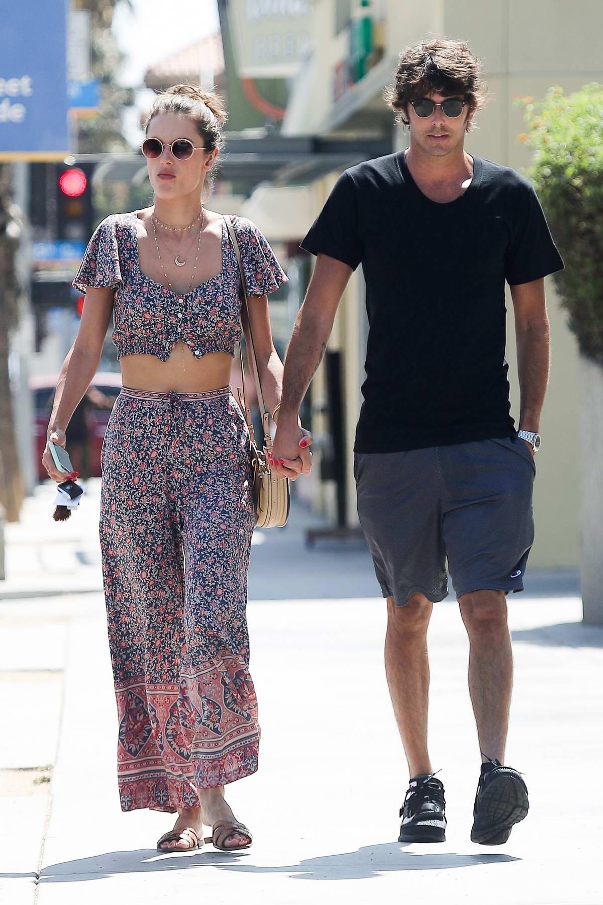 Alessandra Ambrosio enjoys a stroll with boyfriend Nicolo Oddi after a quick lunch in Santa Monica, California