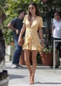 Alessandra Ambrosio wears a yellow summer dress while out for lunch at Ivy At The Shore in Santa Monica, California