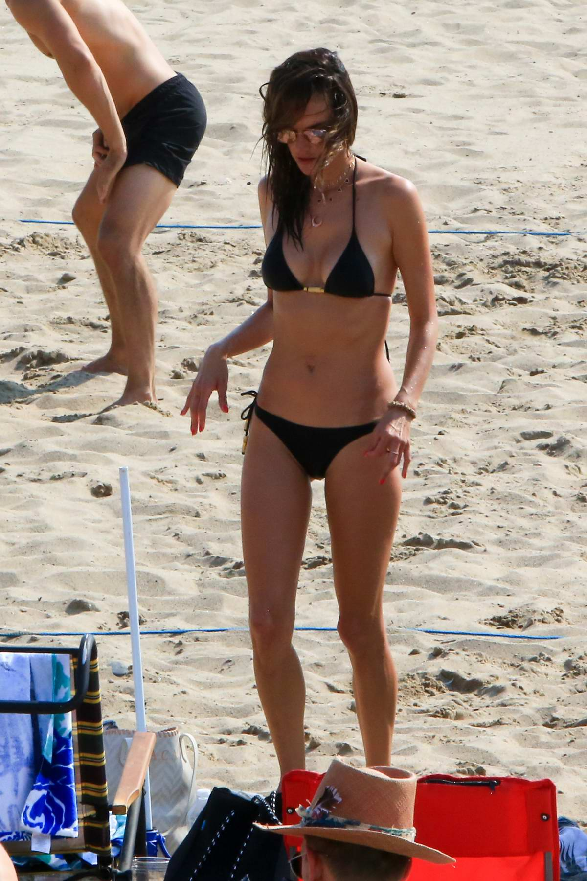 Alessandra Ambrosio wore a black bikini as hang out with her friends at the beach in Los Angeles