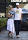 Alice Eve cozies up with a mystery guy as the couple leaves Cafe Gratitude in Los Angeles