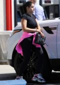 Ariel Winter pairs up black tee with black leggings as she stops by a bank in Studio City, Los Angeles