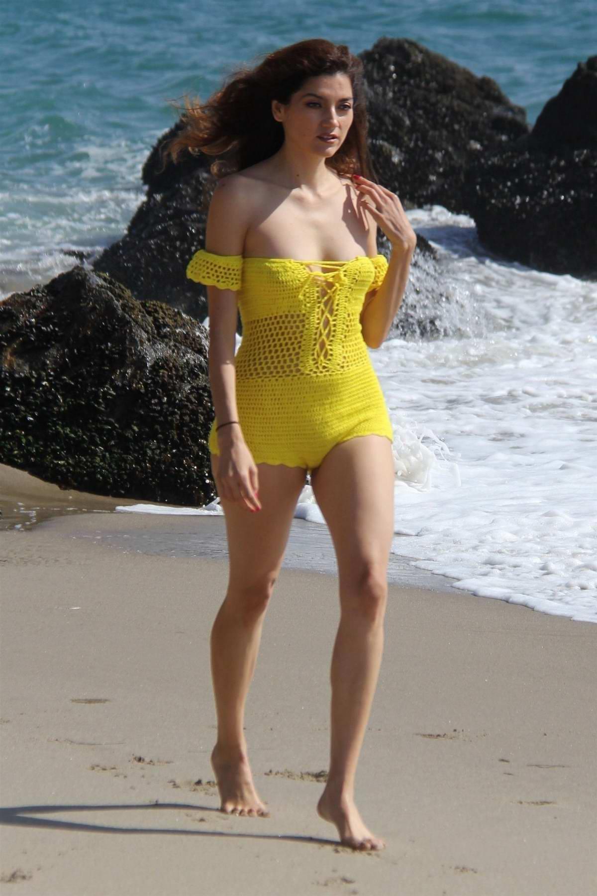 Blanca Blanco hits the beach in a yellow knit swimsuit in Malibu, California