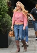 Britney Spears wore a pink top and jeans with knee high brown boots to La Society restaurant in Saint Germain, Paris, France