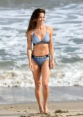 Brooke Burke wears an ONETEASPOON blue bikini on the beach during a video shoot for her fitness app in Malibu, California