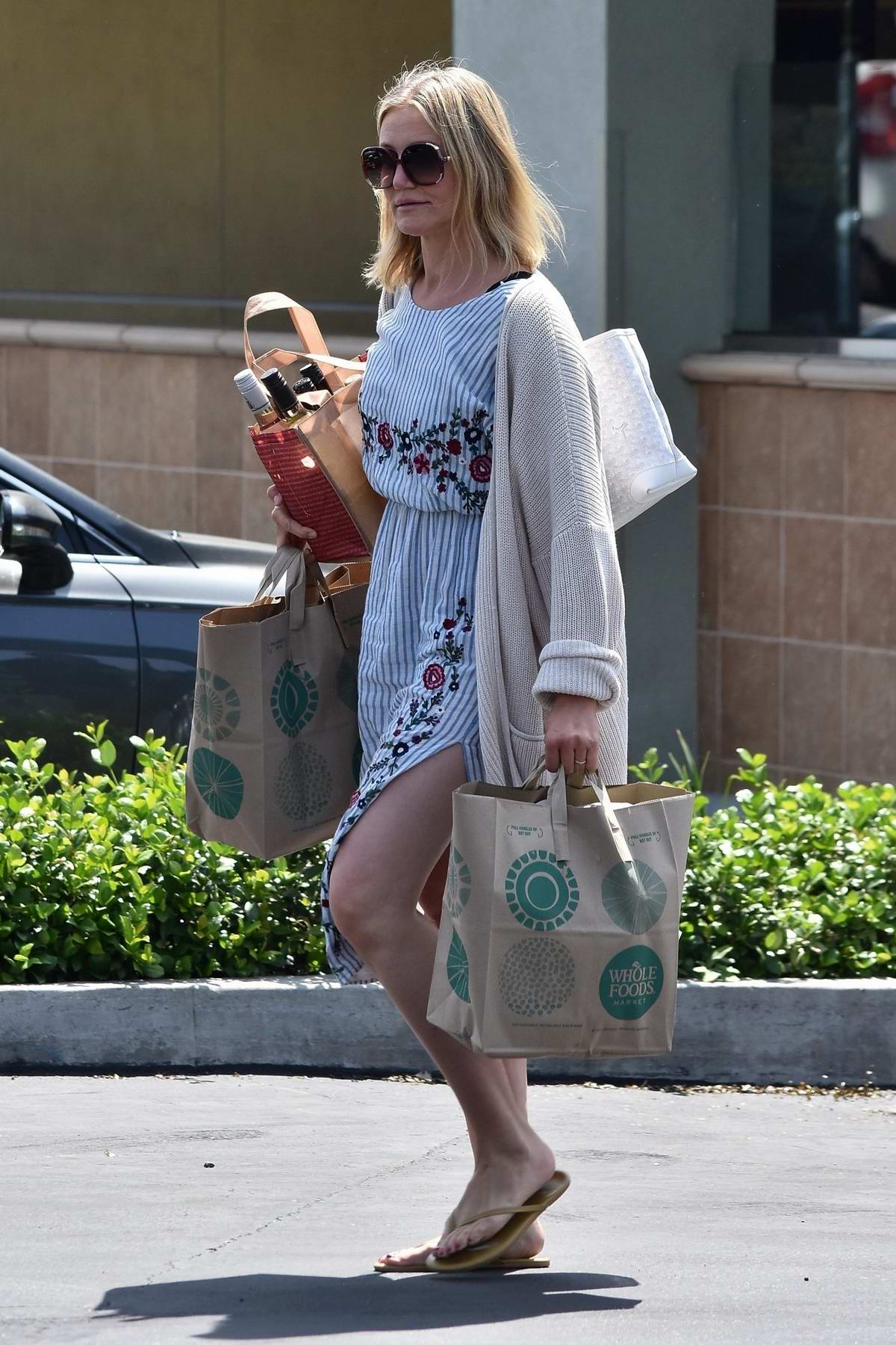 Cameron Diaz wore a blue striped dress as she grabbed some groceries from Whole Foods in Glendale, Los Angeles