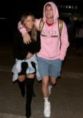 Chloe Bennet and Logan Paul seen arriving at LAX airport in Los Angeles