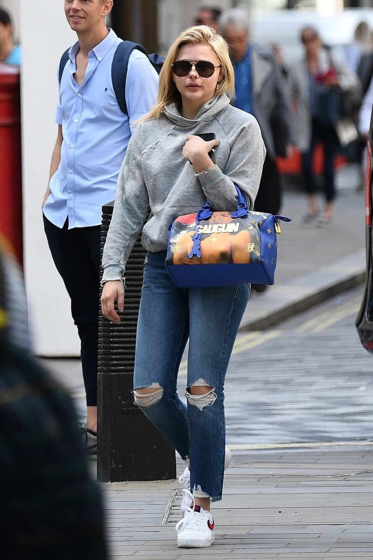 Chloe Grace Moretz seen out and about wearing a grey hoodie and ripped jeans in London, UK