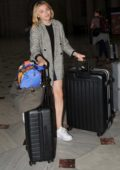 Chloe Grace Moretz sports a no makeup look with a plaid blazer as she arrives into Washington D.C.