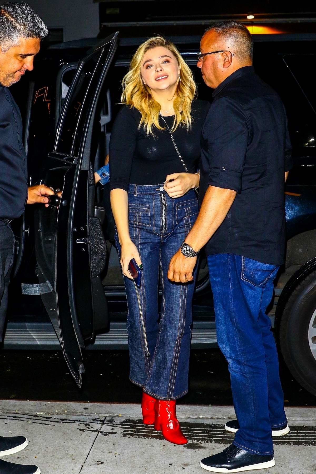 Chloe Grace Moretz spotted in a black top, jeans and red boots as she arrive at at the Quad Cinema in New York City