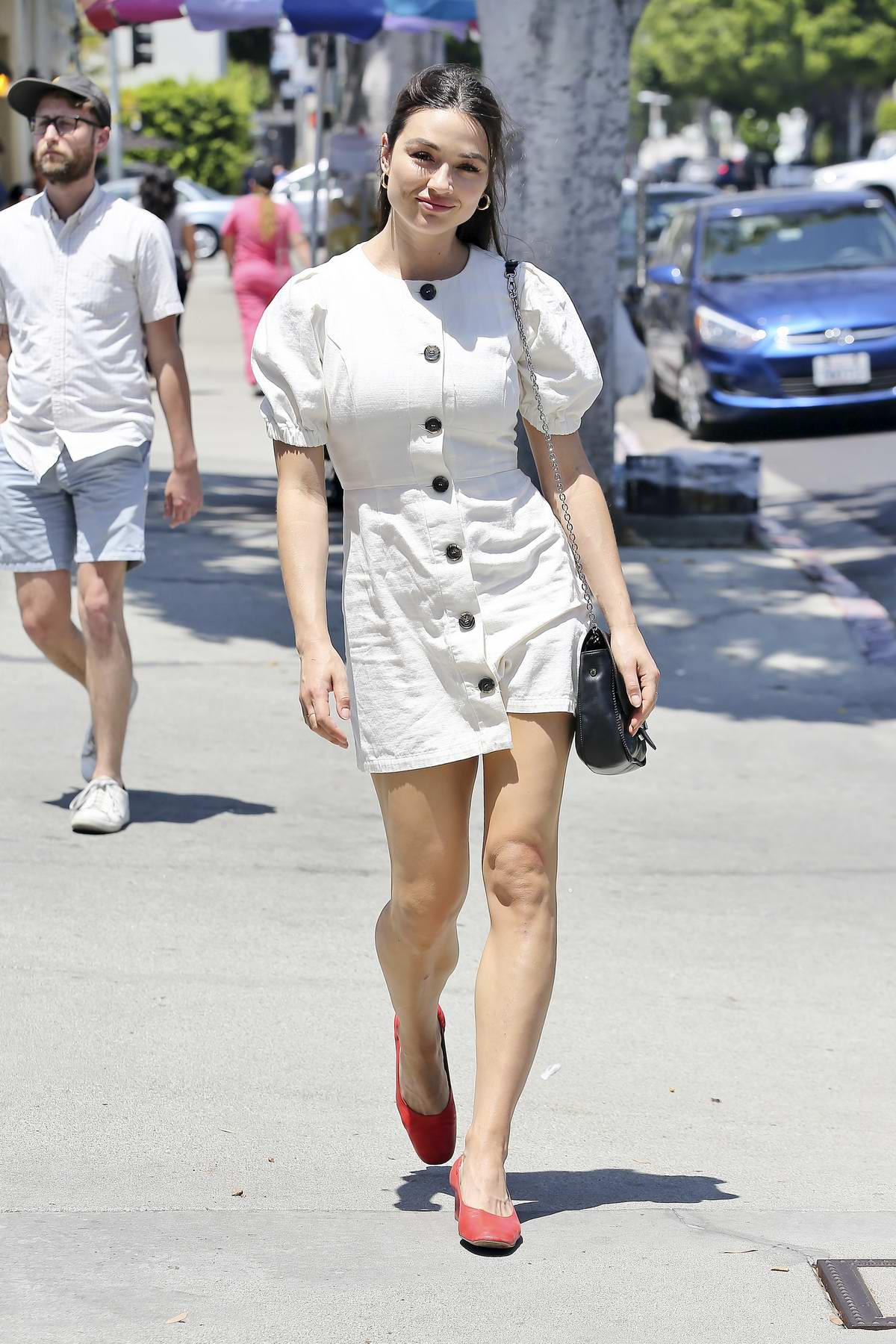 Crystal Reed seen in a white mini dress while out shopping in Los Angeles