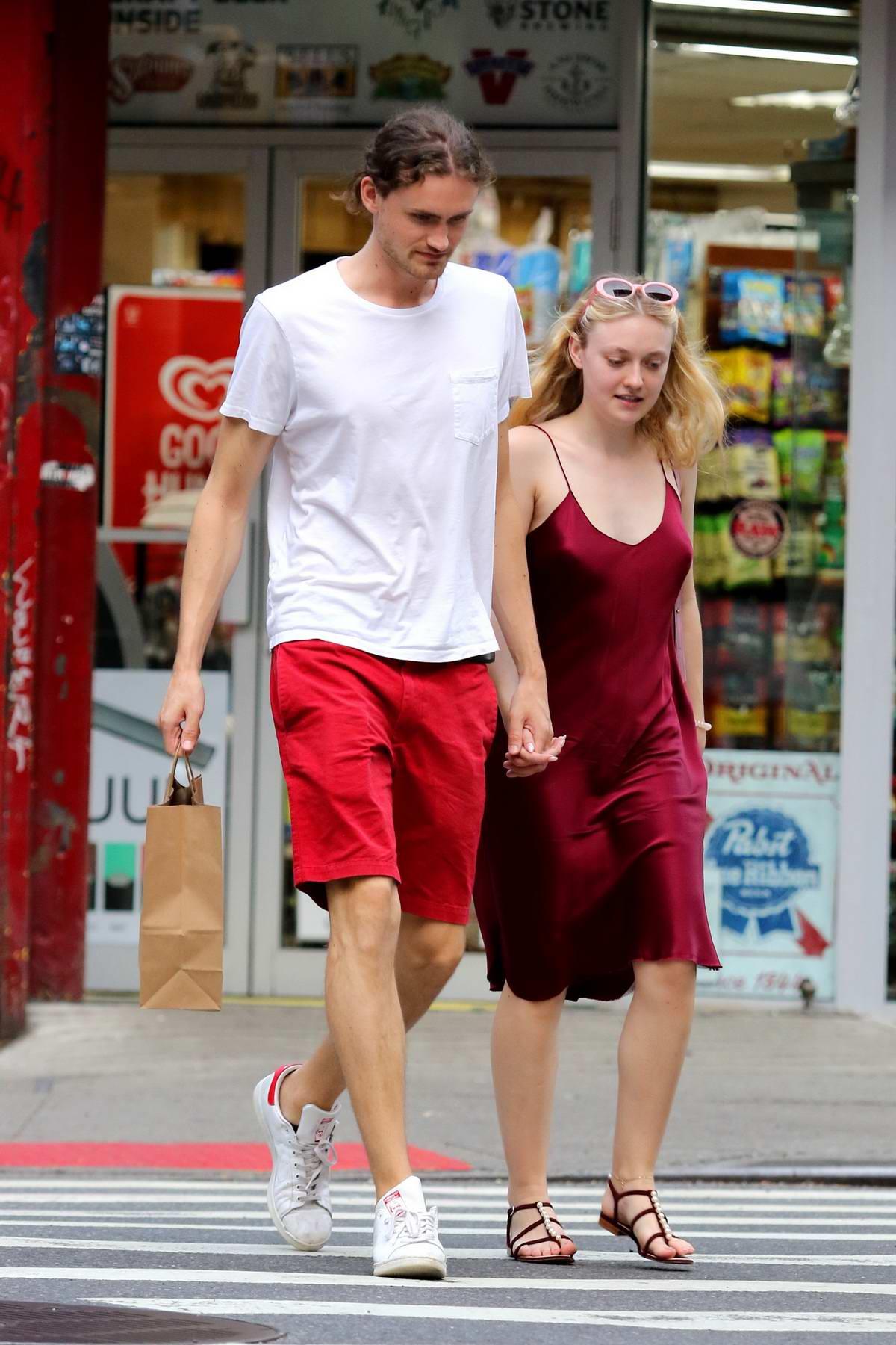 Dakota Fanning seen wearing a red silk dress while enjoying a romantic stroll with boyfriend Henry Frye after dinner in New York City