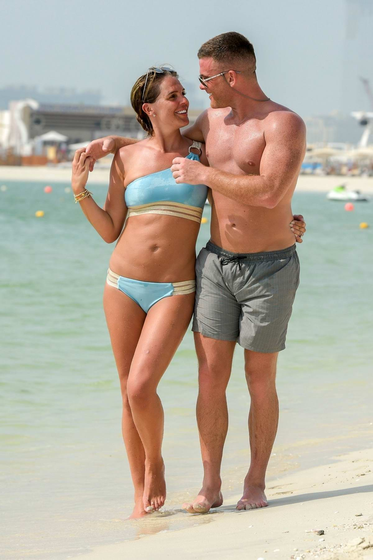 Danielle Lloyd spotted in a turquoise bikini while at the beach with fiance Micahel O'Neil during their holiday in Dubai