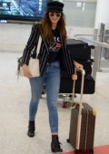 Delta Goodrem touches down at Sydney airport before heading off to check few apartments