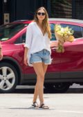 Elizabeth Olsen buys some flowers while out for a stroll with her boyfriend Robbie Arnett in New York City