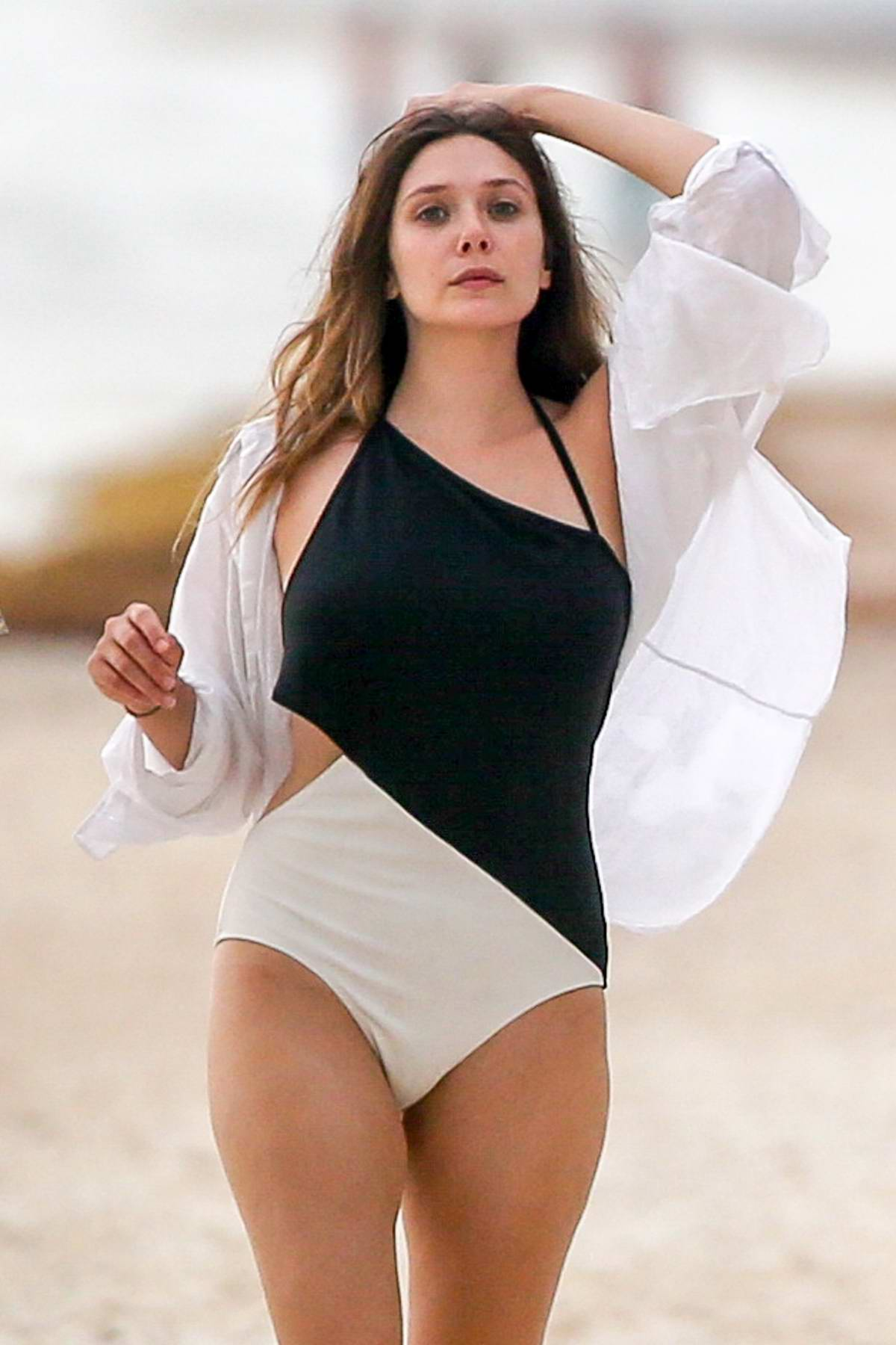 Elizabeth Olsen spotted in a swimsuit while spending a relaxing day at the beach with boyfriend Robbie Arnett in Mexico
