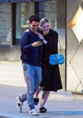 Elle Fanning and Max Minghella gets cozy while out in Mayfair, London, UK