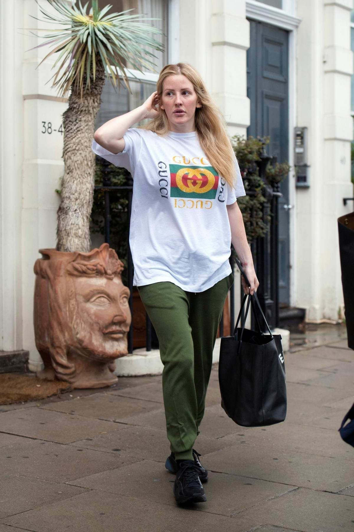 Ellie Goulding steps out in a white Gucci t-shirt and green pants in London