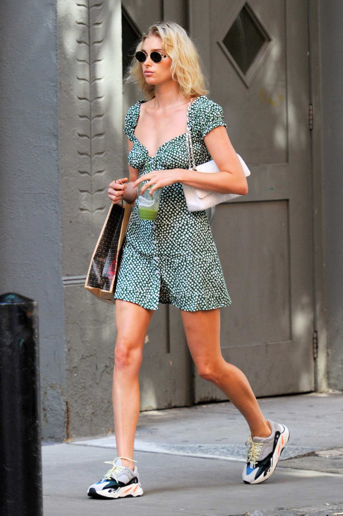 Elsa Hosk spotted in a short dress enjoying some green smoothie while out in New York City