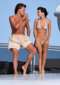 Emily Ratajkowski rocks a polka dot bikini while on a yacht with Jordan Barrett in Sardinia in Porto Cervo, Italy