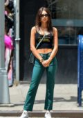 Emily Ratajkowski steps out in a Quentin Tarantino crop tank top with green pinstriped pants in New York City