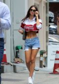 Emily Ratajkowski wears a vintage Coca Cola crop top and denim jeans while out on a stroll after lunch in New York City